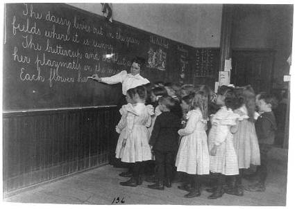 vintage-teacher-at-the-chalkboard